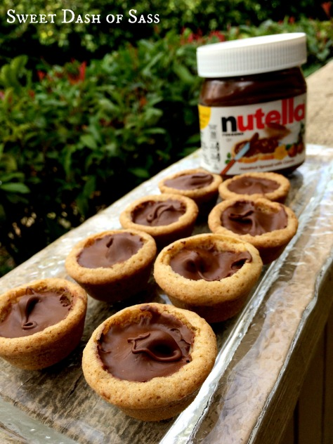 Nutella Filled Cookie Cups - OMG!  So good!  #25DaysCookieStyle www.SweetDashofSass.com
