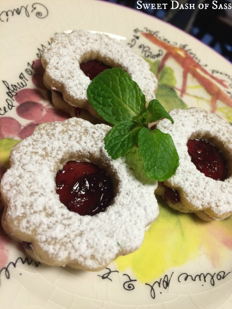 Linzer Cookies - fill with any of your favorite fruit filling - #25DaysCookieStyle www.SweetDashofSass.com